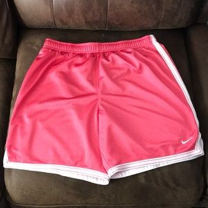 Pink Nike basketball shorts